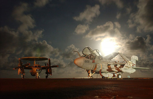 Military Aircraft - dramatic photo - 2 us navy planes on the deck against the night sky backlighted.jpg